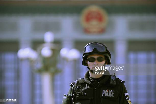 A policeman guards after the closing session of the National Peoples Congress outside The Great Hall Of The People on March 14 2012 in Beijing China...