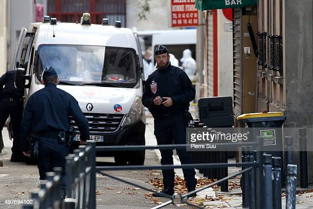 A policeman guards an area of Rue des Corbillon in the northern Paris suburb of SaintDenis following a raid on an apartment on November 18 2015 in...