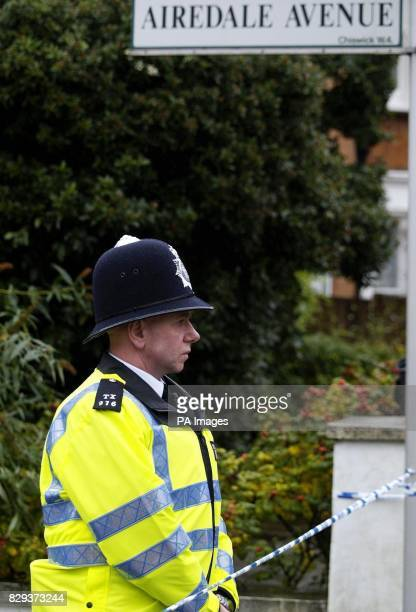 A policeman guards an area outside a house in Airedale Avenue Chiswick west London where a middleaged man is believed to have been stabbed to death...