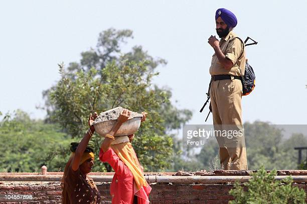 A policeman guards at the Red Fort on September 30 2010 in Old Delhi India