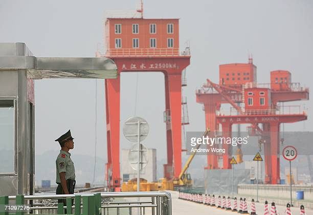 A policeman guards the top of the Three Gorges Dam on June 25 2006 in Yichang Hubei province China The Three Gorges tour is one of the main tourist...
