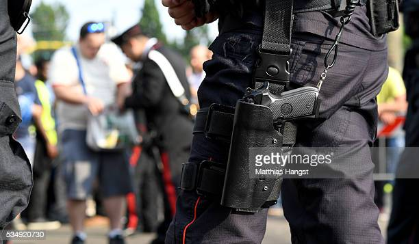 A policeman gun is seen prior to the UEFA Champions League Final match between Real Madrid and Club Atletico de Madrid at Stadio Giuseppe Meazza on...