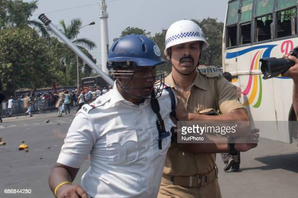 A policeman has got injured during the protest rally while the other is escorting him to a safe place Kolkata India 22 May 2017 After the massive...