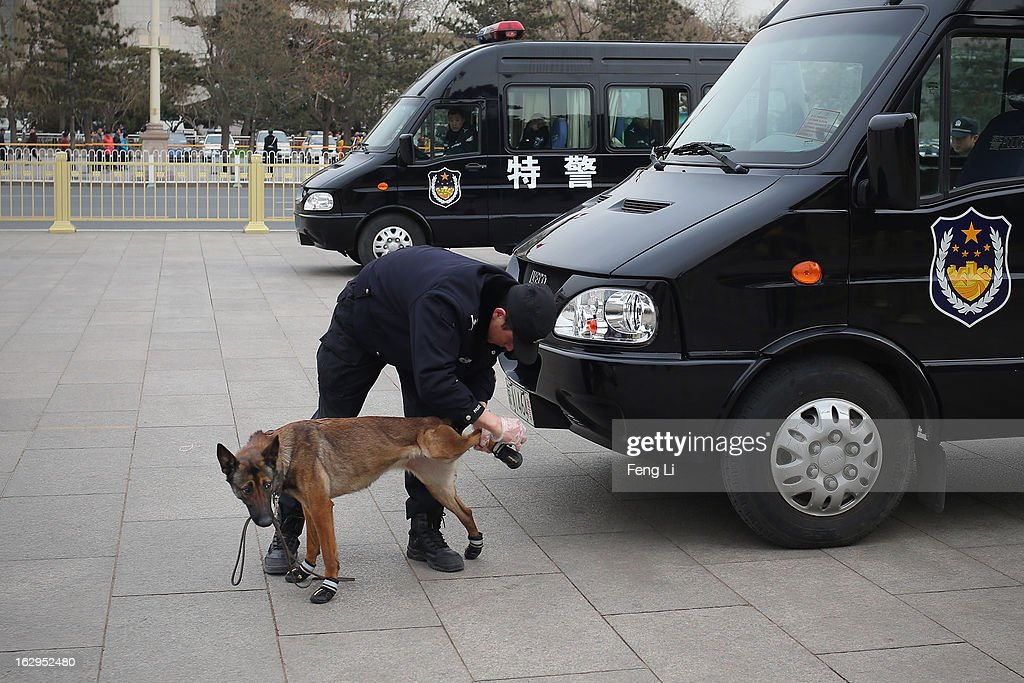 A policeman helps a police dog to wear shoes before a pre-opening session of the Chinese People's Political Consultative Conference (CPPCC) on March 1, 2013 in Beijing, China. The reshuffle will be completed at the first annual session of the 12th National People's Congress (NPC), which is scheduled to begin on March 5, and the first annual session of the 12th National Committee of the Chinese People's Political Consultative Conference (CPPCC), which will commence on March 3.