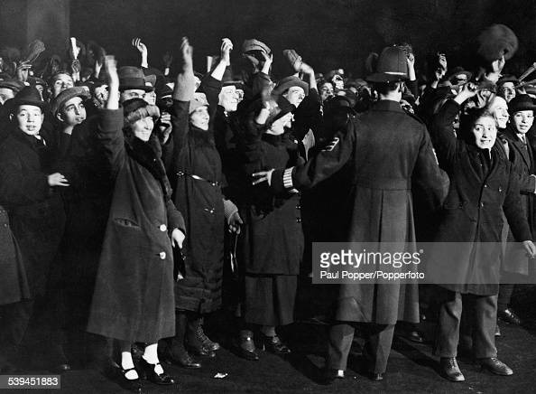 A policeman holds back the crowds in London during the General Election November 1922