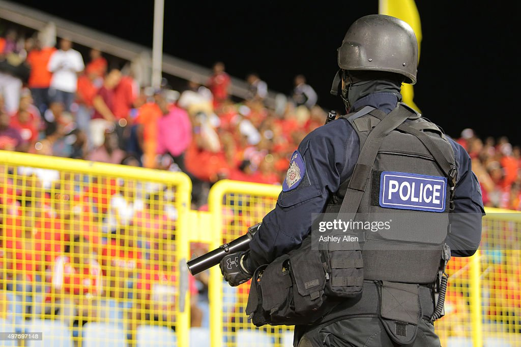 A policeman in full riot gear keeps a close eye during a World Cup Qualifier between Trinidad and Tobago and USA as part of the FIFA World Cup Qualifiers for Russia 2018 at Hasely Crawford Stadium on November 17, 2015 in Port of Spain, Trinidad & Tobago.