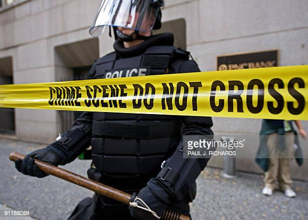 A policeman in riot gear is positioned on a steet during protests in downtown Pittsburgh Pennsylvania as world leaders attend the G20 Summit on...