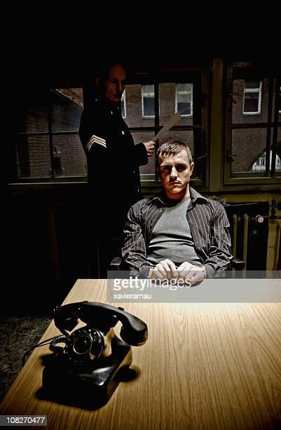 Policeman Interrogating Suspect