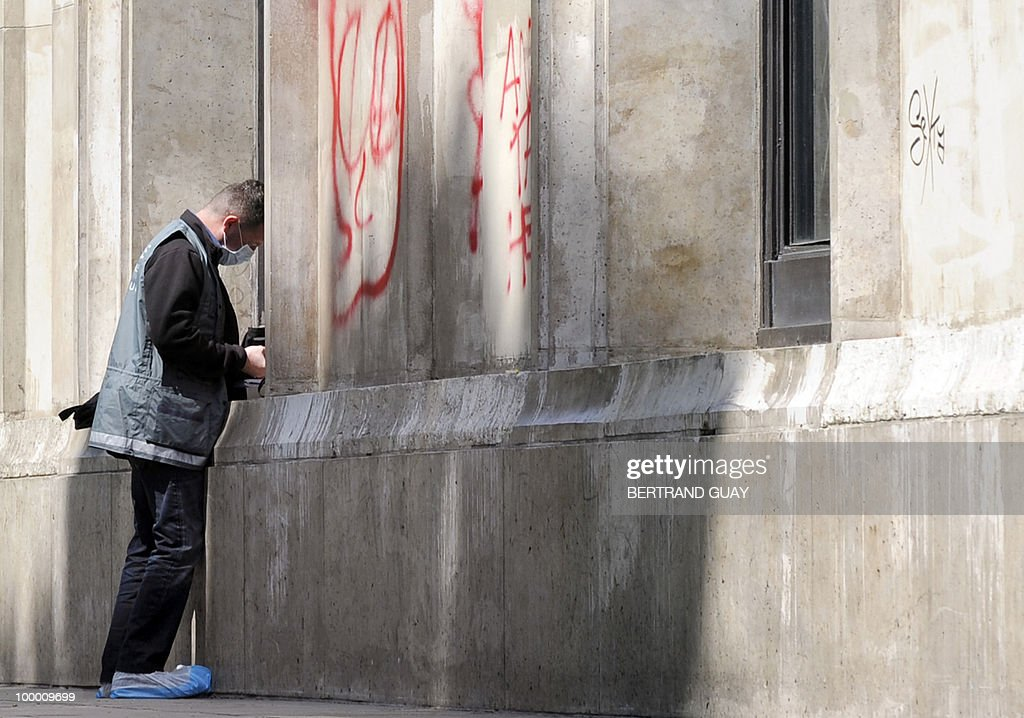 A policeman investigates at the Paris' Musee d'Art Moderne (Paris modern art museum) where five works including paintings by modern masters Henri Matisse and Pablo Picasso have been stolen on May 20, 2010. The canvases, worth a total of 500 million euros (635 million dollars), were discovered missing from the city-run Musee d'Art Moderne when it opened its doors, the sources said.