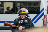 A policeman is seen in 'Rue de la Republique' in SaintDenis on November 18 2015 in SaintDenis France French Police special forces raided an apartment...