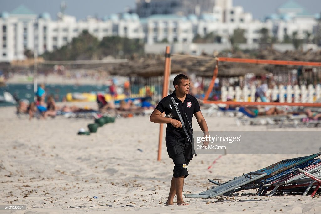 A policeman is seen patrolling the beach ahead of a memorial service for the victims of the 2015 Sousse Beach terrorist attack on June 26, 2016 in Sousse, Tunisia. Today marks the one year anniversary of the Sousse Beach terrorist attack, which killed 38 people including 30 Britons. Before the 2011 revolution, tourism in Tunisia accounted for approximately 7% of the countries GDP. The two 2015 terrorist attacks at the Bardo Museum and Sousse Beach saw tourism numbers plummet even further forcing hotels to close and many tourism and hospitality workers to lose their jobs.