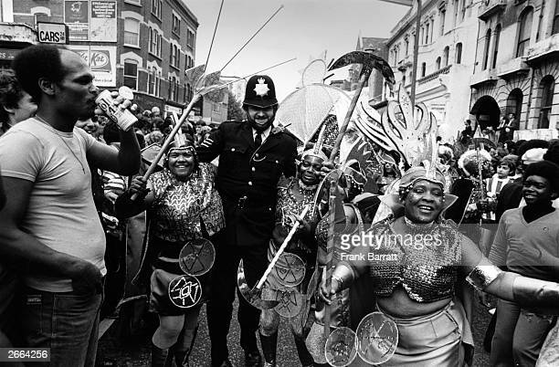 A policeman joining in with the festivities at the Notting Hill Carnival in west London