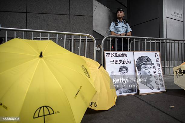 A policeman keeps vigil as supporters of the Occupy movement show their support to student protesters outside the Wanchai police station in Hong Kong...