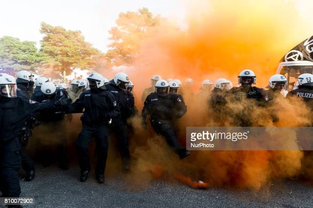 A Policeman kicks a smoke grenade in Hamburg Germany on July 6 2017 The police stopped the leftradical demonstration quotG20 Welcome to Hellquot and...