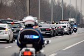 A policeman looks at taxi drivers blocking the traffic on December 15 near Le Bourget outside Paris during a demonstration to protest against a...