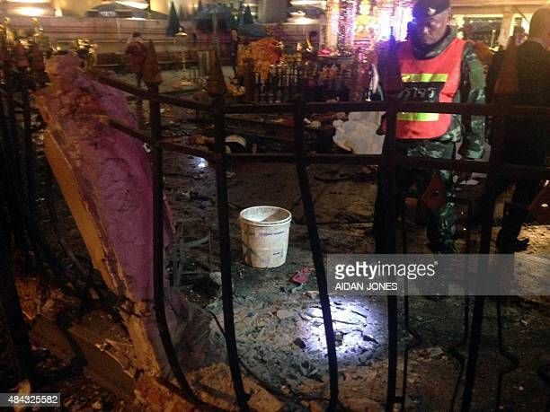 A policeman looks at the scene of devastation after a bomb exploded outside a religious shrine in central Bangkok late on August 17 2015 killing at...