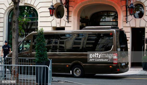 A policeman looks on as a vehicle understood to be transporting the entourage of Brazilian footballer Neymar after he arrived on August 4 arrives at...
