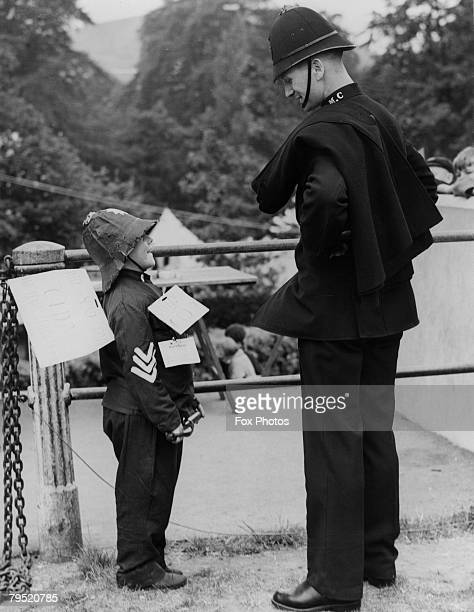 A policeman meets a small boy dressed as a police sergeant during a fancy dress competition at a carnival in aid of Pontypool Hospital South Wales...