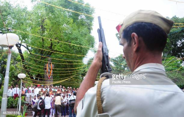 A policeman offers a gun salute to honour to Freedom fighter Chandra Shekhar Azad on his 109th birthday anniversary at Azad Park in Allahabad Azad is...