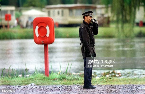 A policeman on duty near a lake in Northampton where an unidentified boday was found earlier today Sevenyearold Raymond Southall disappeared from a...