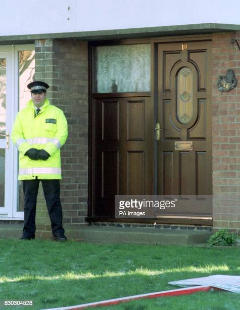 A policeman on duty outside 10 Ndola Drive Horncastle Lincs the home of David Broddle and Lorraine Richardson who were found discovered in a car at...