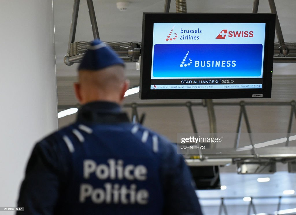 A policeman patrols during the partial reopening of the departure hall of Brussels Airport in Zaventem on May 1, 2016, after it was badly damaged in twin suicide attacks on March 22, that killed 16 people. A total of 32 people were killed and more than 300 wounded in coordinated suicide bombings at the airport and a metro station in central Brussels on March 22 in Belgium's worst ever terror attacks. / AFP / JOHN