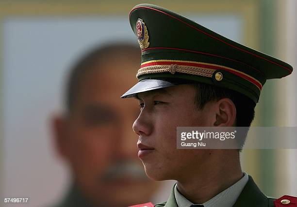 Policeman patrols in front of a giant portrait of Sun Yatsen the founder of modern China erected for the upcoming May Day at Tiananmen Square on...