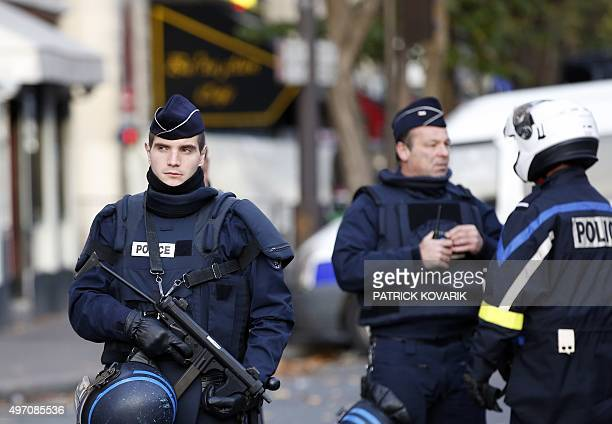 A policeman patrols near the Bataclan concert hall in Paris on November 14 following a series of coordinated attacks in and around Paris late Friday...