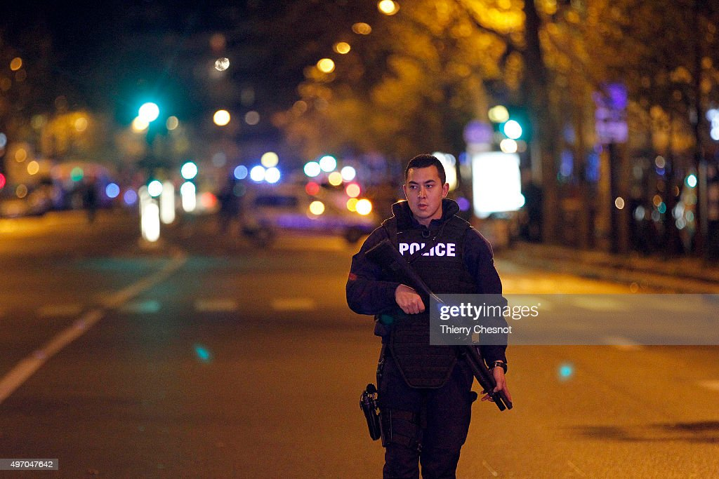 A policeman patrols near the Boulevard des FillesduCalvaire after an attack November 13 2015 in Paris France Gunfire and explosions in multiple...