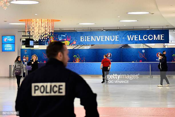 A policeman patrols the lobby of the Palais des Congres in Paris on December 12 ahead of the draw for the UEFA Euro 2016 football championships...