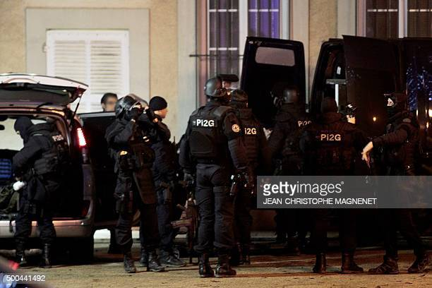 A policeman prepares his gear and equipment on December 8 2015 in La Mole near the city of SaintTropez southeastern France during the search for the...