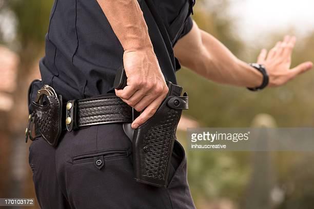 Policeman preparing to draw his gun