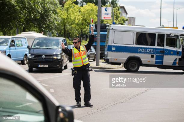 A policeman regulates the traffic in Kreuzberg after a fire broke out in a construction site in Berlin Germany on June 19 2017