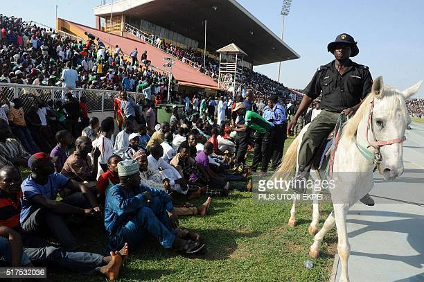 A policeman rides a horse as he patrols during the African Cup of Nations qualification match between Egypt and Nigeria on March 25 in Kaduna / AFP /...