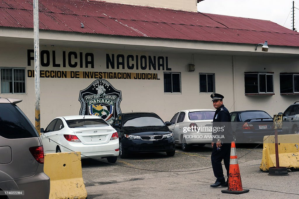 A policeman satnds in front of the National Police of Panama (DIJ) headquarters in Panama City on July 19, 2013. According to the Italian Ministry of Justice, Robert Seldon Lady aka 'Mister Bob', former head of the CIA in Milan, was arrested in Panama. AFP PHOTO / Rodrigo ARANGUA