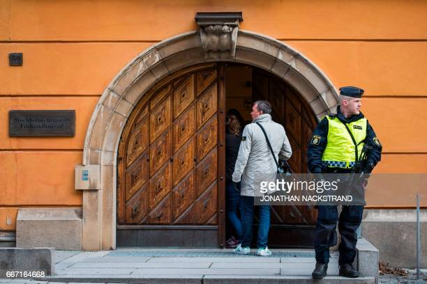 A policeman secures the entrance to the Stockholm District Court where Uzbek national Rakhmat Akilov prime suspect in the Stockholm truck attack...