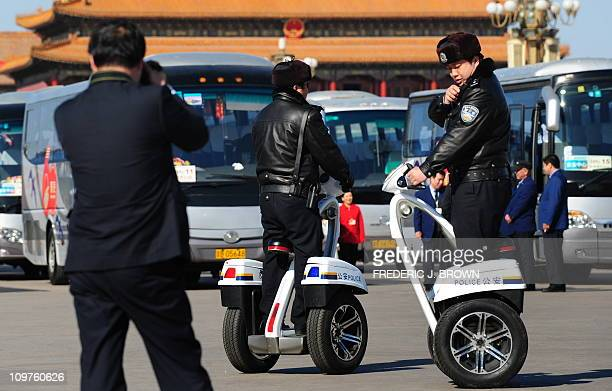 A policeman speaks into his radio while riding on a segwaytype vehicle patrolling Tiananmen Square closed off to the general public during ramped up...