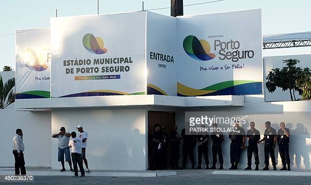 Policeman stand at the entrance of the Antonio Carlos Magalhaes municipal stadium in Porto Seguro during a training session of Switzerland's national...