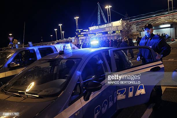 A policeman stand at the entrance of the Juventus stadium before the Italian Serie A football match Juventus Vs AC Milan on November 21 2015 in Turin...