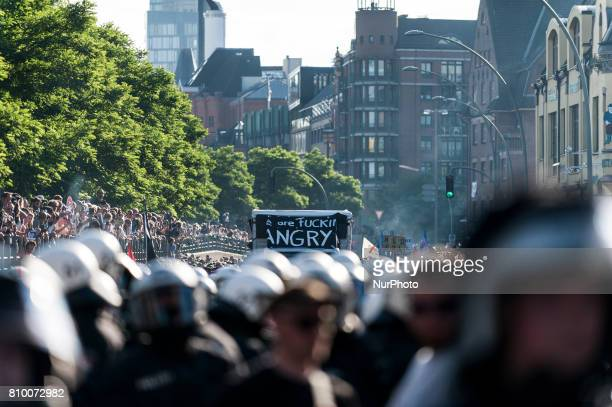 Policeman stand in front of the march in Hamburg Germany on July 6 2017 The front transparent of the demonstration in Hamburg Germany on July 6 2017...