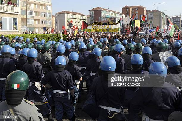 Policeman stand in front of 'Turin's Book fair' during a demonstration against Israel in Turin on May 10 2008 Like its Parisian counterpart in March...