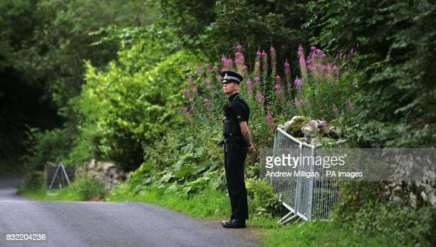 A policeman standing at the rear entrance of Black Lodge in the Scottish Borders where Christopher 'Pascal' Norris who is believed to have died of...