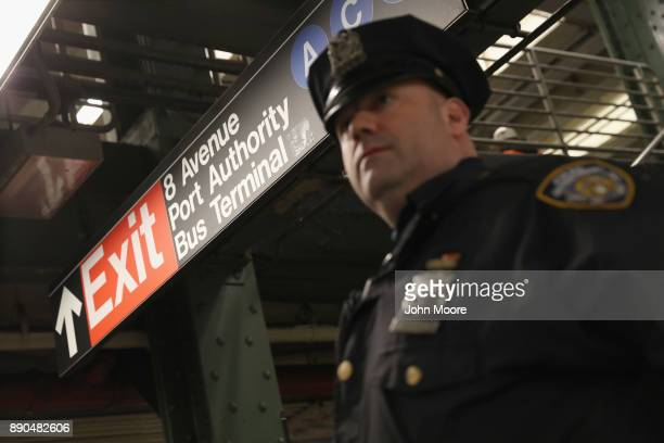 A policeman stands at a closedoff underground walkway near the site of a pipe bomb explosion on December 11 2017 in New York City Police said that...