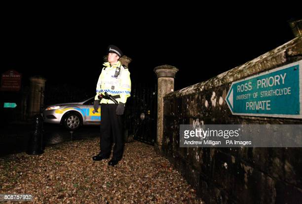 A policeman stands at the entrance to the Ross Priory at in the Garadhban forest in Gartocharn near Loch Lomond as an explosion in the remote forest...