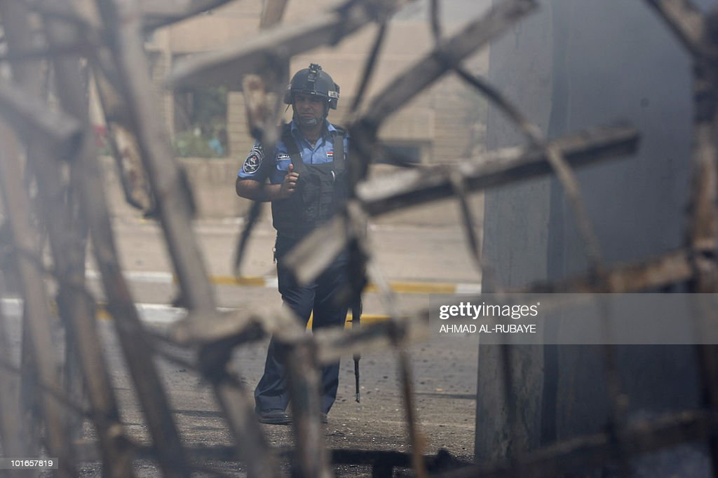 A policeman stands at the scene of a sui