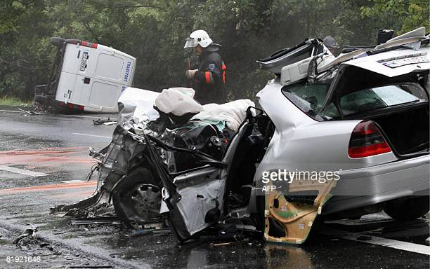 A policeman stands at the site of the car crash in which former Polish Foreign Minister Bronislaw Geremek was killed on the road near the locality of...