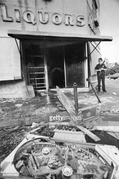 A policeman stands guard a liquor store in Miami was robbed on Dec 31 1982