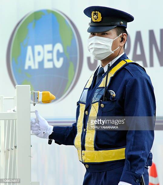 A policeman stands guard at a checkpoint near the AsiaPacific Economic Cooperation venue in Yokohama suburban Tokyo on November 8 ahead of the...
