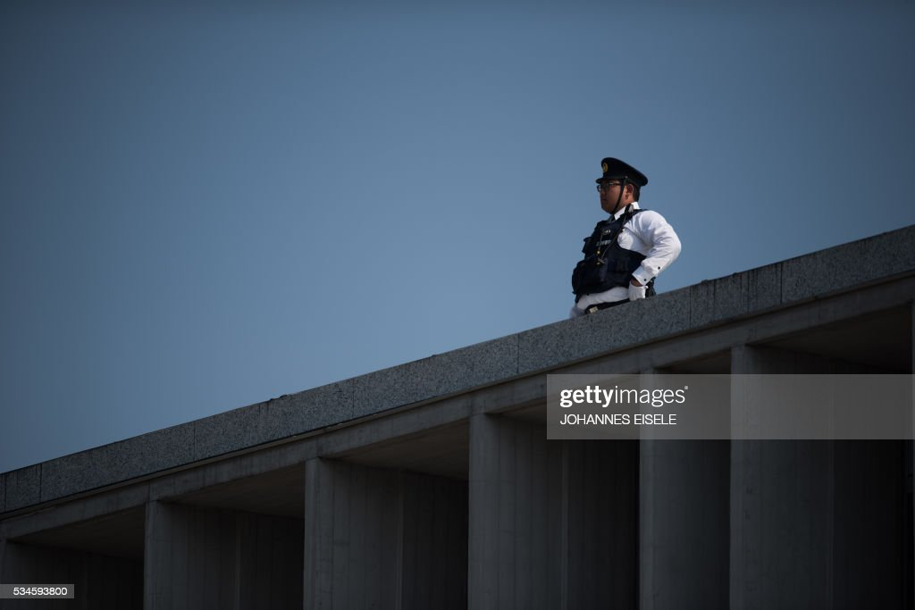 A policeman stands guard at the Hiroshima Peace Memorial in Hiroshima on May 27, 2017. US President Barack Obama was to make history later on May 27 when he travels to Hiroshima -- becoming the first sitting US leader to visit the site that ushered in the age of nuclear conflict. / AFP / JOHANNES