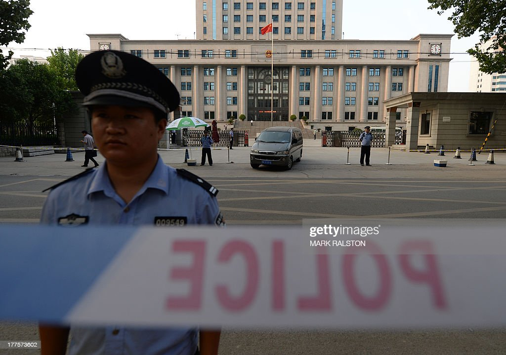 A policeman stands guard during the trial of disgraced politician Bo Xilai at the Intermediate People's Court in Jinan, Shandong Province on August 24, 2013. Once one of China's highest-flying politicians, Bo Xilai found himself in the criminal dock on trial for bribery and abuse of power in the country's highest-profile prosecution in decades. AFP PHOTO/Mark RALSTON